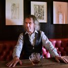 Owner Ivor Braka with artwork by Tom of Finland at the Gunton Arms. Picture: DENISE BRADLEY