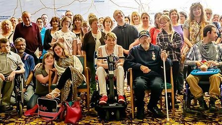 Disabled people, their parents and carers gathered at a public meeting at County Hall. Pic: Philip W
