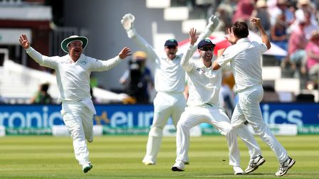 Ireland's Tim Murtagh celebrates with his team mates after bowling out Moeen Ali by lbw during day o