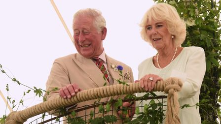 Prince Charles and the Duchess of Cornwall on a garden viewing platform at the Sandringham Flower Sh