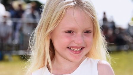 Dulcie Bonser, five, ready to present the posy to Prince Charles and the Duchess of Cornwall at the
