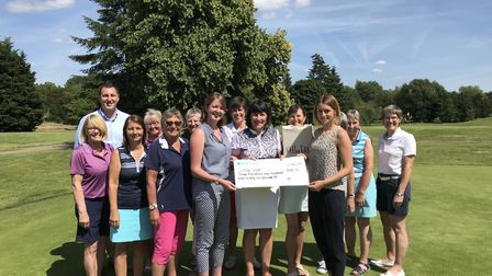 Dunston Hall Ladies' captain Sue Henderson presents a cheque for more than £3,000 to the Littlelifts