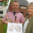 Stone carver Teucer Wilson and Maggie Abel of Abel Homes with the plans for a giant walnut sculpture