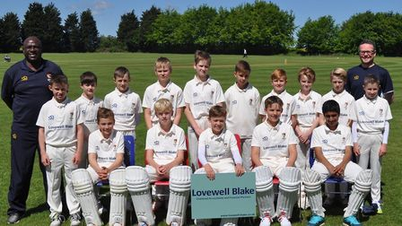 Norfolk's Under-11s line up for a team picture with coach Mick Piggott (left) and manager Tony Baile