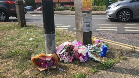 Floral tributes laid at the junction in Diss where Maureen Self died after being hit by a postal lor