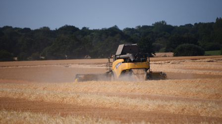 Fire crews were called to a combine harvester fire in Terrington St John. Picture: DENISE BRADLEY