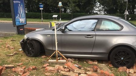 A silver BMW 2 series crashed into the wall at the BP garage on the A47 in Lowestoft. Photo: Ashleig