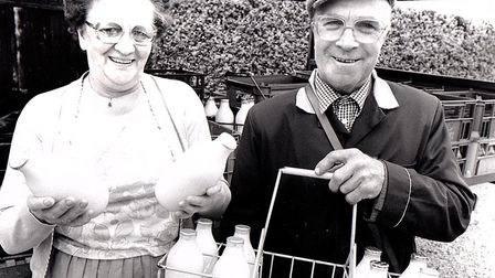 Popular milkwoman Gwen Dearsley with her husband Charles Dearsley, delivering milk to the village. P