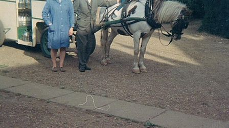 Gwen and Charles Dearsley with one of village children on horse and cart used to deliver milk around