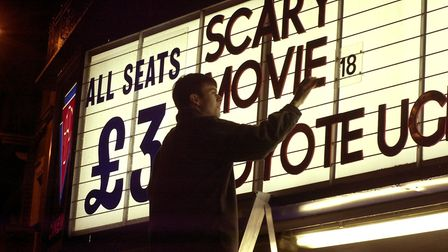 ABC Cinema's Jonathan Davis removing letters from the Prince fo Wales Road cinema during the last fi