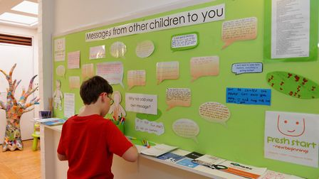 A child by one of the notice boards at the Ipswich centre of Fresh Start - new beginnings. Photo: Fr