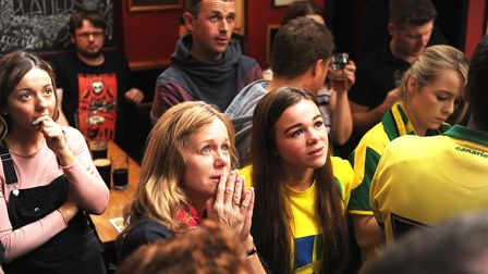 Norwich City fans Alison Greenacre and her daughter Meg watching the derby in the Coach and Horses.