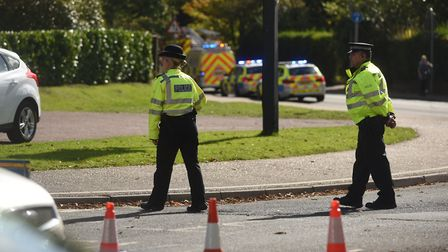 Police at the scene of a crash involving a lorry and a pedestrian on Station Road in Attleborough. P