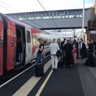 Passengers wait for news at Peterborough station during travel disruption on the East Coast mainline