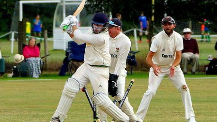 Oliver McGee has his stumps re-arranged after going for a big hit off Ashley Watson during Norfolk's