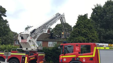 Firefighters tackle a house fire at a home in Mousehold Lane in Norwich. Picture Dan Grimmer.