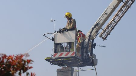 A firefighter on board an aerial platform. Picture: Chris Bishop
