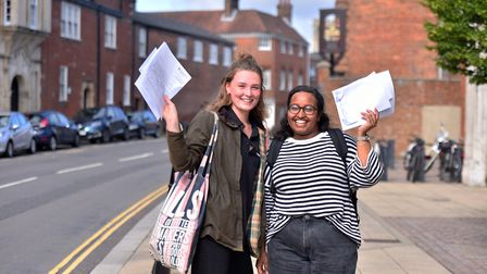 Poppy Clarke, left, and Merewa Abdu with their results on A-Level results day at Sir Isaac Newton Co