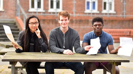 From left, Jason Yan, George Latoy and Michael Taiwo with their A-Level results at Notre Dame Sixth