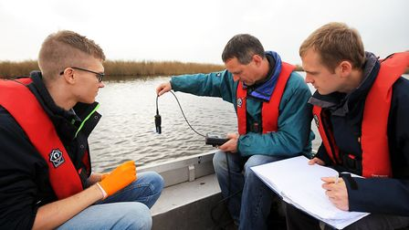 Edward Hems, Dr Martin Rejzek and Dr Ben Wagstaff check for toxic algae in the Broads in 2014 Pic