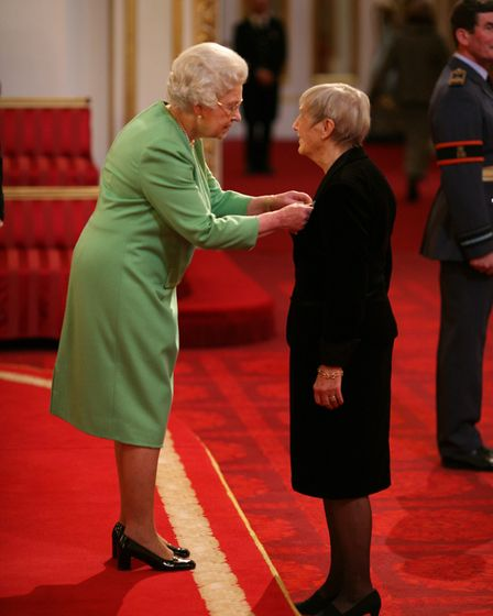 Nancy Pearce was made an OBE by The Queen at Buckingham Palace on December 11, 2007, for her work in