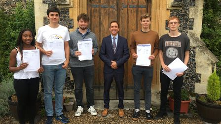 Principle of Thetford Grammar School, Michael Brewer, with his year 13 students who have a achieved