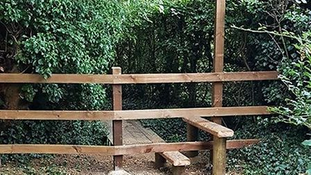 A vicar in Mulbarton has defended the erection of a fence and stile on a public footpath behind the