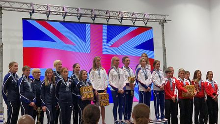 The GB women's team are presented with their gold medals at the IAU 50K World Championships in Roman