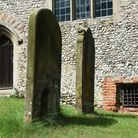 The smaller entrance door by the grille to the crypt at All Saints Church at Swanton Morley. Picture