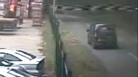 CCTV footage showing the van that failed to stop at the scene of the crash that killed cyclist Sze-M