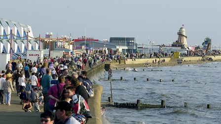 Holidaymakes throng the promenade during the evening high tide at Hunstanton. 06/24/01