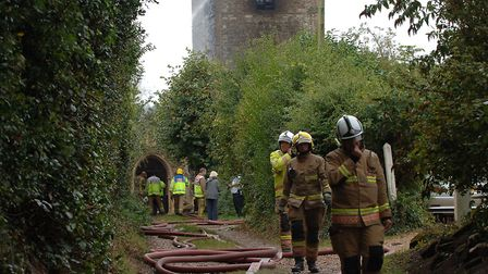 Firefighters at the scene of the blaze which has gutted the historic church at Wimbotsham, near Down