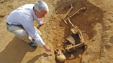 The 2009 excavations revealed a 4th Century AD skeleton. Prof Will Bowden with the find. Pic: Antony