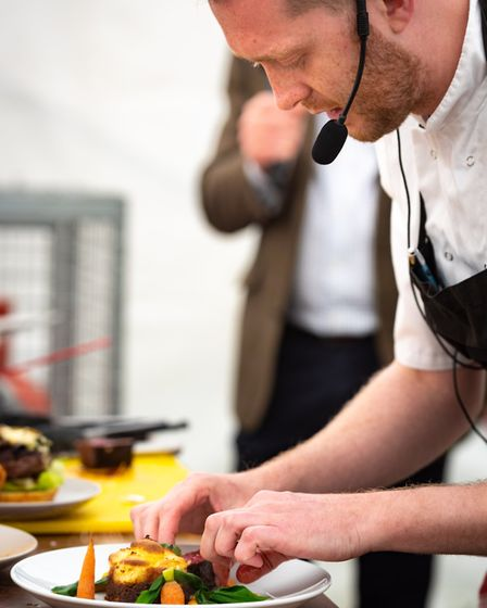 Last Wine Bar chef Iain McCarten in action doing a cookery demo. Pic: Archant