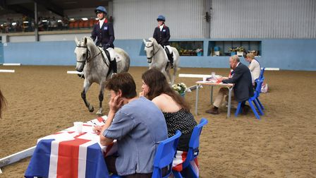 The Great Britain team pass the judges during the early rounds of the dressage event at the Great Br