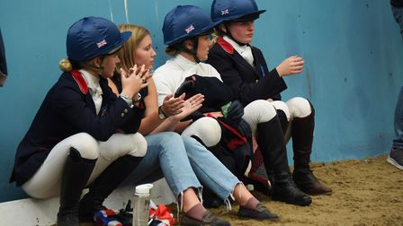 The Great Britain team watch as other teams take part in the dressage at the Great Britain Student R
