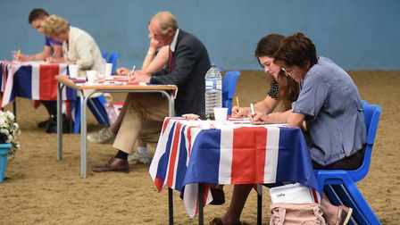 The judges mark the dressage event at the Great Britain Student Riders Nations Cup being hosted at E