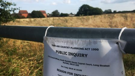 A planning inquiry was held after Orbit Homes appealed against the refusal of new homes on two field