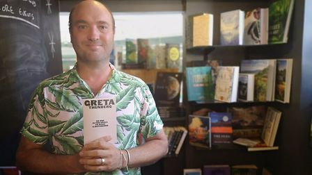 Henry Layte of The Book Hive is giving away copies of Greta Thunberg's book. Picture: Ruth Lawes