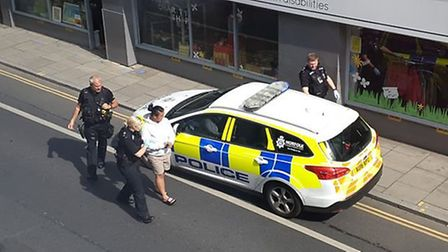 Police led people away after an incident in Magdalen Street in Norwich. Pic: Submitted.