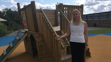 Katie Lawson, principal of Costessey Primary School, outside one of the new outdoor play areas. Pict