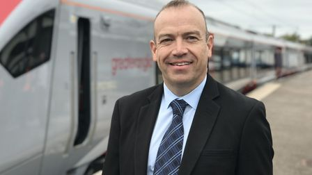 Minister of State for Transport, Chris Heaton-Harris at Norwich station with one of the new Greater