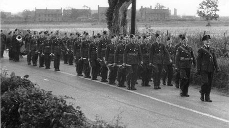 Staff from RAF Watton march down Norwich Road to attend the funerals of the three airmen who died in