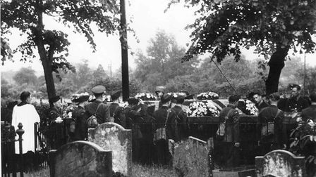 Revd James Royan of St Mary's in Watton conducting the funeral of the three airmen who died in a cra