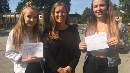 Pupils and best friends Egle Valiunaite, left, with exective headteacher Penny Bignell, centre, and