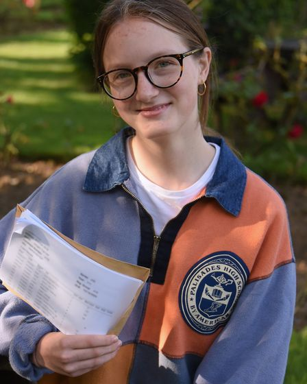 Imogen Lee celebrates her GCSE results, which include four 9 grades and four 8 grades, at Wymondham