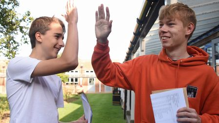 High five from Iwan Cary, left, and Jack Andrews, as they celebrate their GCSE results at Wymondham