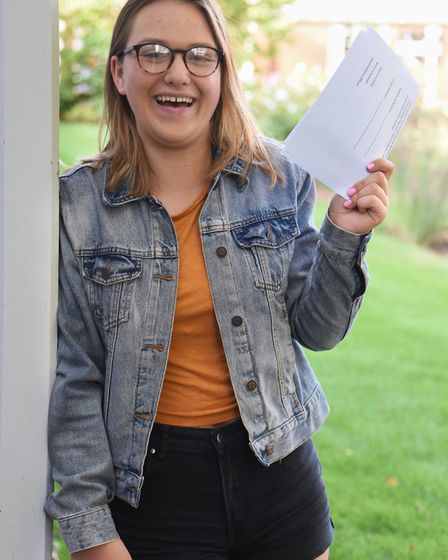 Charlie Farmer celebrates her GCSE results which include four 9 grades, and four 8 grades, at Wymond
