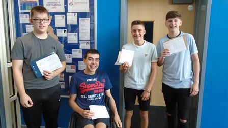 Taverham High School students Daniel, James, Myron and Max celebrate their GCSE results. Picture: Ta