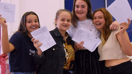 Students at Wayland Academy celebrate their GCSE results. From left, Sidal Dilek, Kiera Smith, Lily